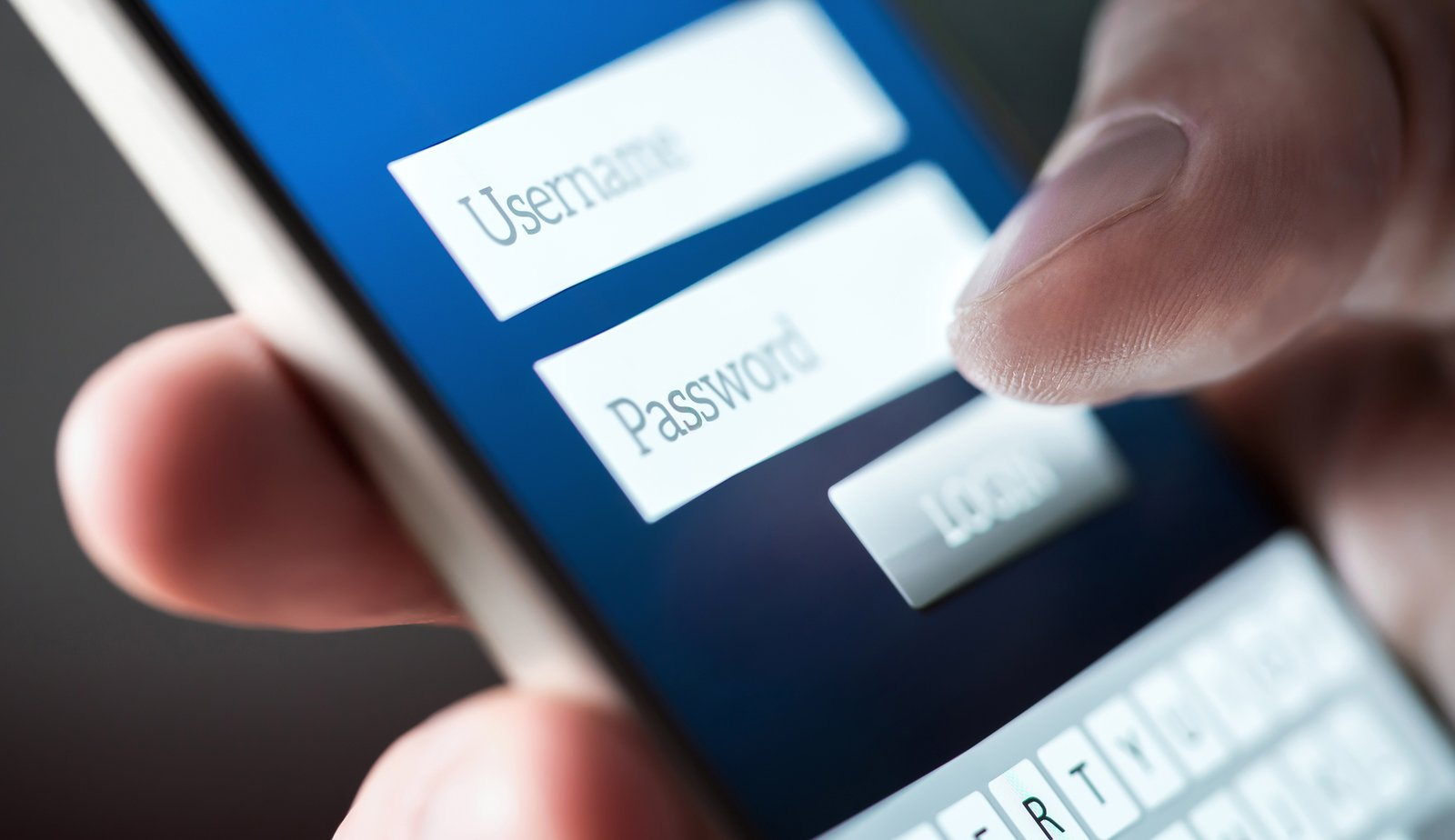 User logging in on a smartphone, example of fraud or identity theft.