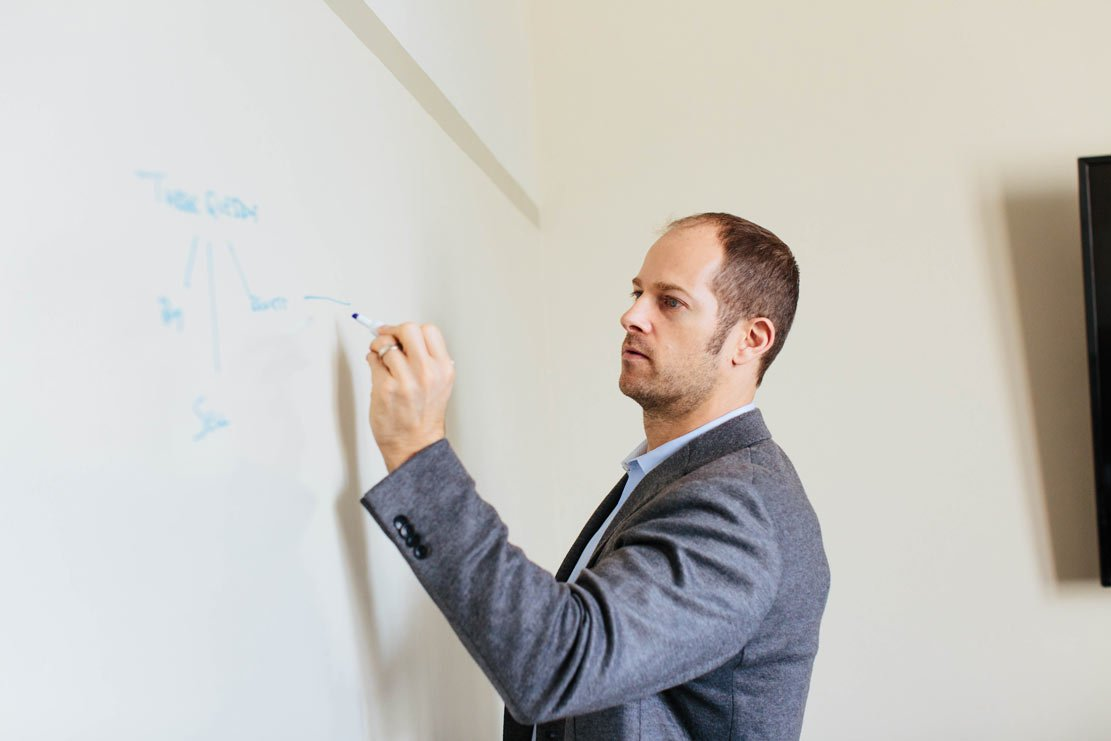 Managing Partner Ben Beck of Beck Bode LLC writing on a whiteboard.