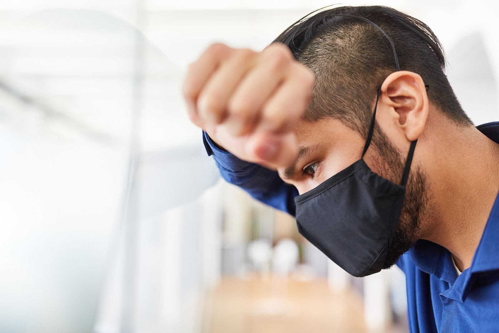 Businessman in office with face mask for Covid-19.